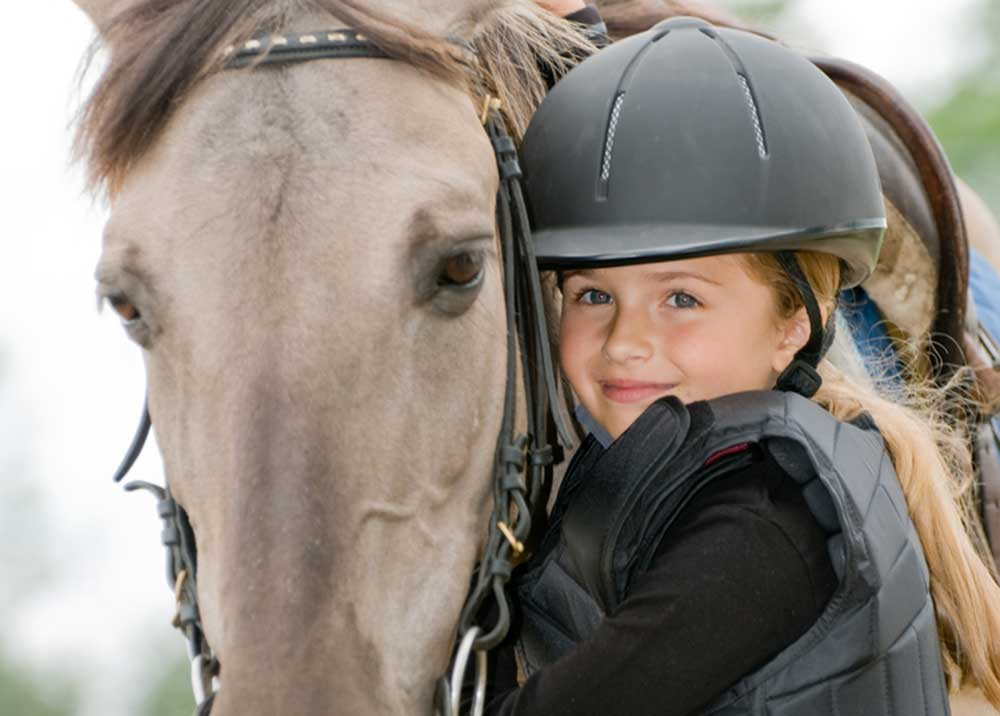 Girl with horse -Summer Riding Camps and Clinics